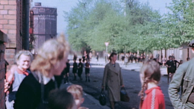 german army medical troops surrendering driving through town and civilians on the roadside waving to them / tannenbergsthal germany - 1945 stock-videos und b-roll-filmmaterial