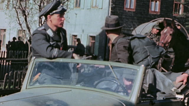 german army officers and wives sitting waiting in open staff cars during surrender gi sitting behind m1919 machine gun and german army officer being... - 1945 stock-videos und b-roll-filmmaterial