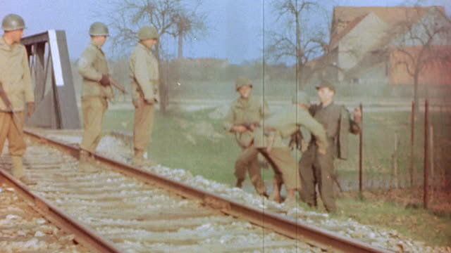 german army prisoner of war being roughly frisked by us army soldiers escorted to an officer and interrogated during world war ii european campaign /... - prisoner of war stock videos & royalty-free footage