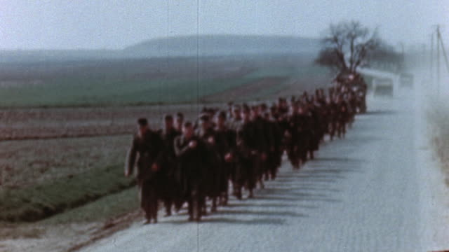 german army prisoners of war walking in formation along side of road / germany - prisoner of war stock videos & royalty-free footage