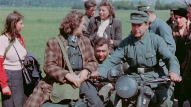 vídeos de stock, filmes e b-roll de ha german army soldier on motorcycle transporting civilians and another soldier - wehrmacht