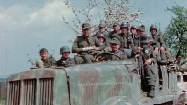 vídeos de stock, filmes e b-roll de pan german army soldiers in armored personnel carrier driving in to surrender - wehrmacht