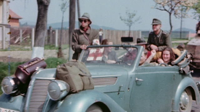 vídeos y material grabado en eventos de stock de german army soldiers in convertible with red cross sign and trucks driving past us army mp to surrender - wehrmacht