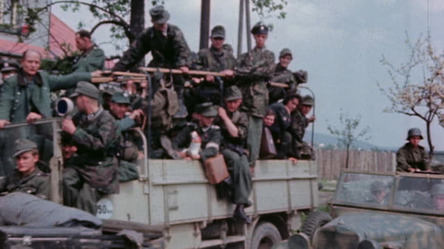 pan german army soldiers in trucks driving slowly in to surrender - wehrmacht stock videos & royalty-free footage