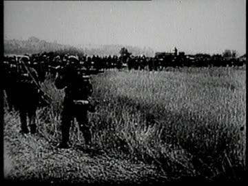 vidéos et rushes de german army troops marching / france - infanterie