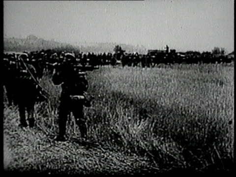 vídeos de stock, filmes e b-roll de german army troops marching / france - wehrmacht