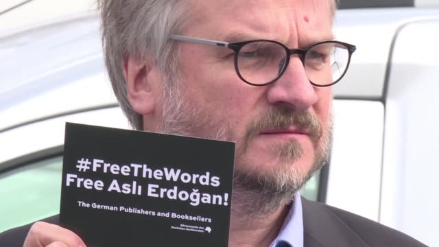 German authors and editors gather in front of a women's jail in Istanbul to show their support to novelist Asli Erdogan who is in pretrial detention...