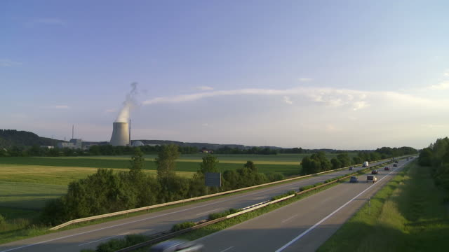 stockvideo's en b-roll-footage met german autobahn and nuclear power station - geschwindigkeit