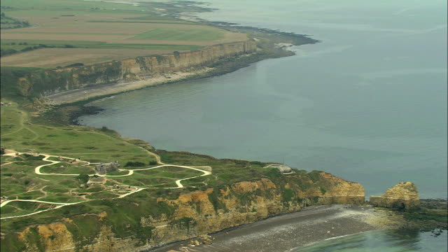 aerial, german battery on cliff top, pointe du hoc, normandy, france - normandie stock-videos und b-roll-filmmaterial