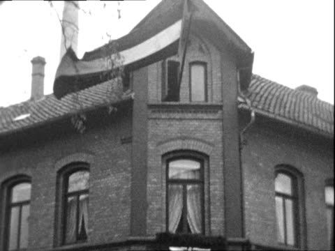 german brick buildings decorated with nazi flags and german reichsflag pan across rain - 1938 stock-videos und b-roll-filmmaterial