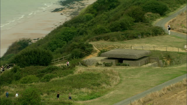 aerial, zo, german bunker on cliff top, pointe du hoc, normandy, france - omaha beach stock videos and b-roll footage