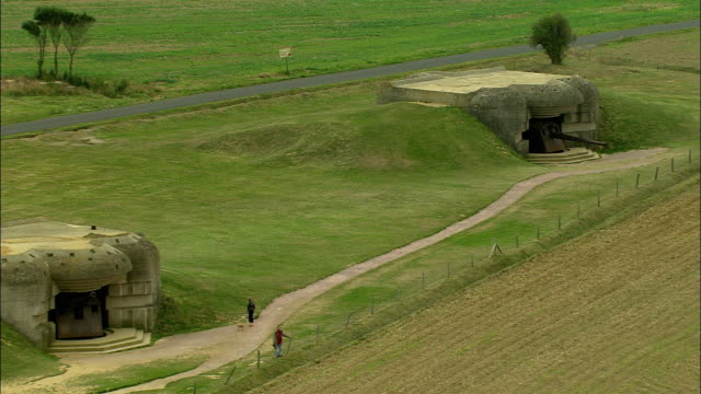 low aerial, german bunkers, pointe du hoc, normandy, france - bomb shelter stock videos & royalty-free footage