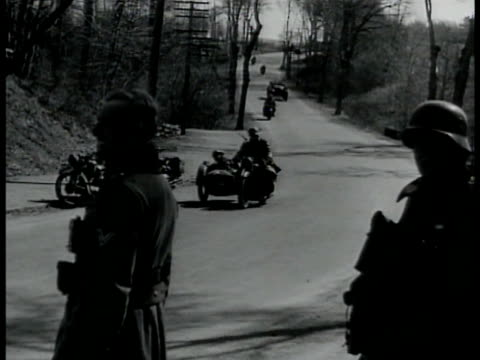 german cars & motorcycles w/ sidecar passing turn on road soldiers standing fg. queen wilhelmina of the netherlands in flannel coat being... - sidecar stock videos & royalty-free footage