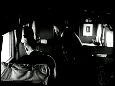 german chancellor adolf hitler and two officers watch the bombing of poland from an airplane - poland stock videos & royalty-free footage