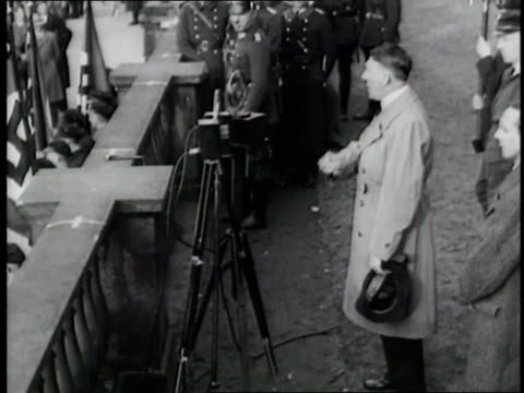 vídeos de stock, filmes e b-roll de german chancellor adolf hitler delivers a speech, then rides through a cheering crowd. - adolf hitler