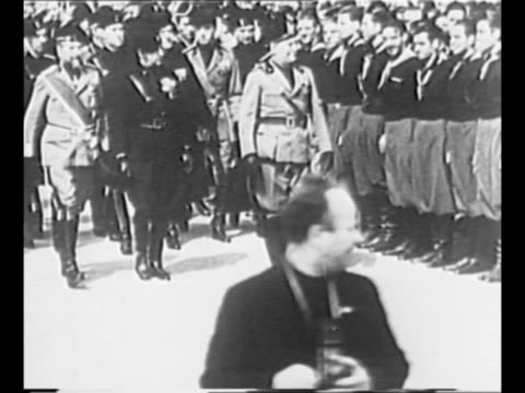 vidéos et rushes de german chancellor adolf hitler deplanes in venice to meet with italian dictator benito mussolini in 1934 young man in foreground faces him issues... - 1934