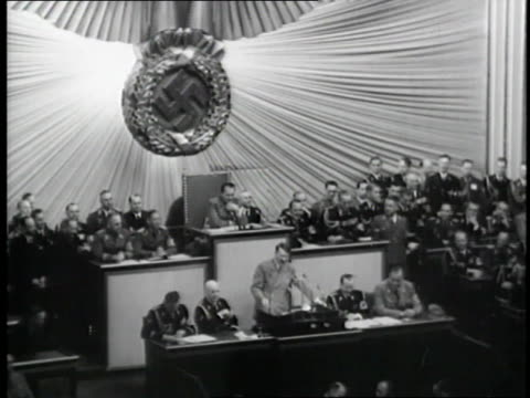 vídeos de stock, filmes e b-roll de german chancellor adolf hitler gives a speech suppressing civil liberties to parliament in reichstag, germany. - adolf hitler