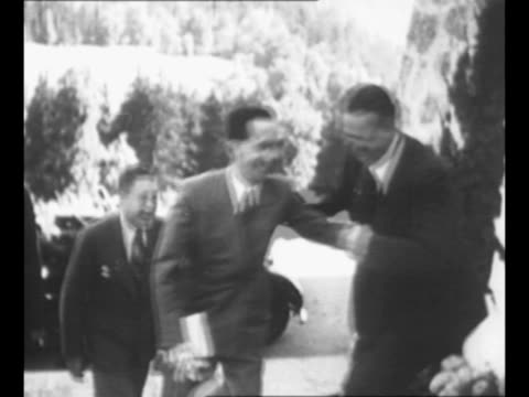 german chancellor adolf hitler kneels, smiles as he talks with little boy at his berchtesgaden estate; woman stands in background / berlin district... - 1930 1939 stock videos & royalty-free footage