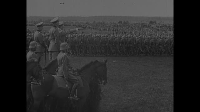 german chancellor adolf hitler on reviewing stand with horses in foreground, marching soldiers beyond; hitler salutes; german soldiers goose... - stepping stock videos & royalty-free footage