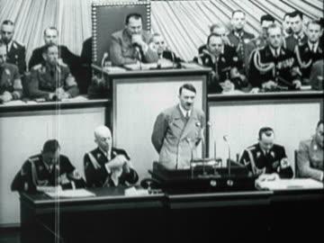 vidéos et rushes de german chancellor adolf hitler speaking to the reichstag in berlin - 1941