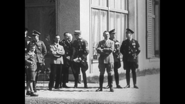 german chancellor adolf hitler standing in front of reich chancellery building with his chief aide hermann goering on his left and two army staff... - hermann goering stock videos & royalty-free footage
