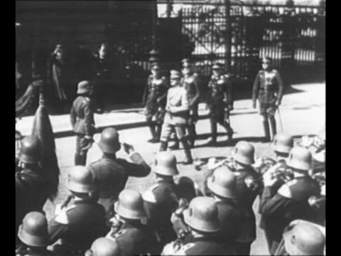 ws german chancellor adolf hitler walks on the wilhelmstrasse in berlin with other nazi officials as military band plays in foreground / ms hitler... - hermann goering stock videos and b-roll footage