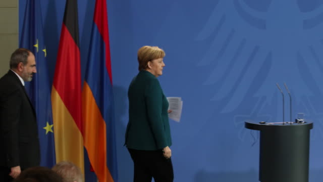 German Chancellor Angela Merkel and Armenian Prime Minister Nikol Pashinyan arrive to speak to the media following talks at the Chancellery on...