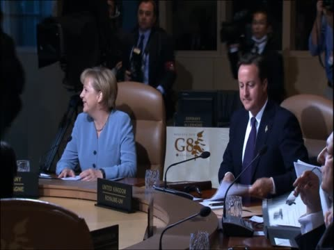 german chancellor angela merkel and british prime minister david cameron sit at table for g8 summit talks - g8 summit stock videos & royalty-free footage