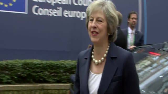 german chancellor angela merkel and british prime minister theresa may address assembled media as they arrive at the council of the european union on... - 2016 video stock e b–roll