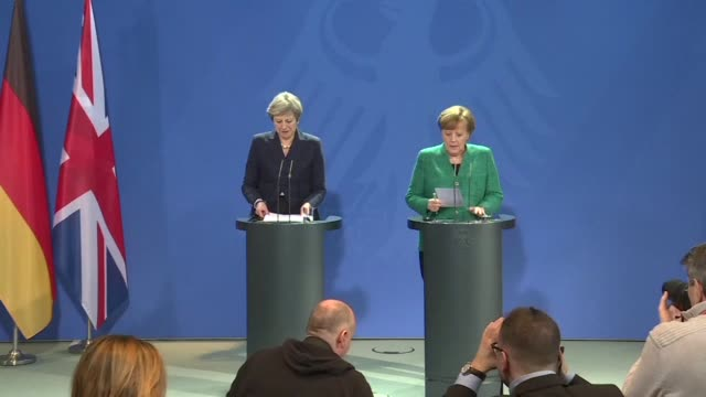 German Chancellor Angela Merkel and British Prime Minister Theresa May arrive for a joint press conference at a Munich security conference