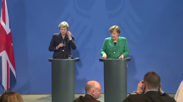 German Chancellor Angela Merkel and British Prime Minister Theresa May arrive for a joint press conference in Berlin