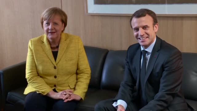 german chancellor angela merkel and french president emmanuel macron held a bilateral meeting on thursday on the sidelines of an eu summit - angela merkel stock videos & royalty-free footage