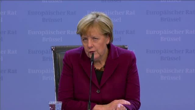 german chancellor angela merkel and french president francois hollande give a press briefing at the end of an eu summit in brussels belgium late... - chancellor stock videos and b-roll footage