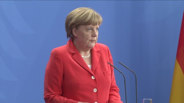 German Chancellor Angela Merkel and French President Francois Hollande hold a press conference at the Federal Chancellery in Berlin Germany on May 19...