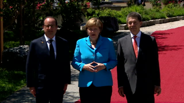German Chancellor Angela Merkel and husband Joachim Sauer welcome French President Francois Hollande G7 member states continue their 2day summit at...