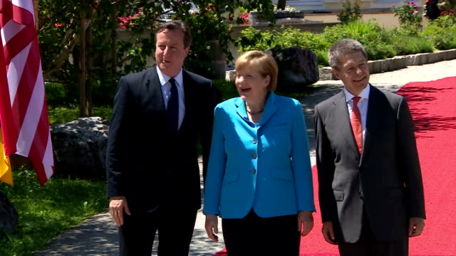German Chancellor Angela Merkel and husband Joachim Sauer welcome British Prime Minister David Cameron G7 member states continue their 2day summit at...
