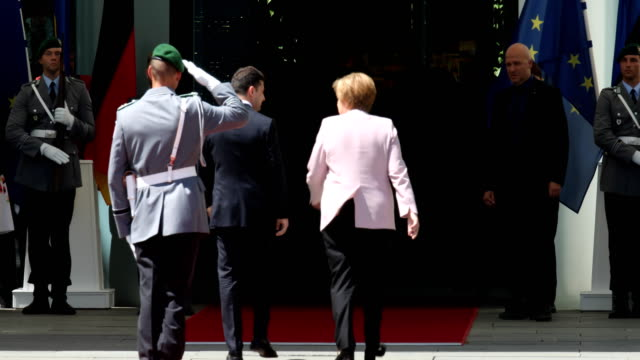 german chancellor angela merkel and new ukrainian president volodymyr zelensky enter the chancellery after reviewed a guard of honor at the... - angela merkel stock videos & royalty-free footage