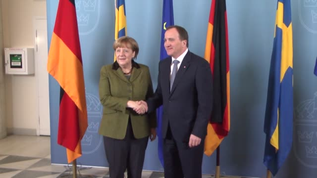 German Chancellor Angela Merkel and Swedish Prime Minister Stefan Lofven hold a joint press conference following their meeting in Stockholm Sweden on...