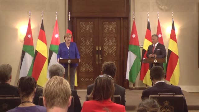 German Chancellor Angela Merkel announces they will credit 100 million dollars to lighten Jordan's IMF reforms during a press conference with...