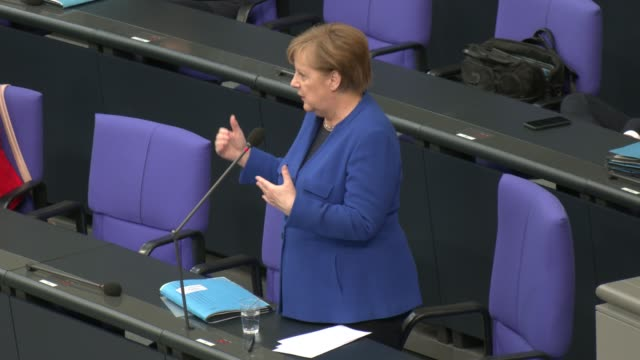 german chancellor angela merkel answers question posed from parliamentarians during a question and answer session at the bundestag during the... - regierung stock-videos und b-roll-filmmaterial
