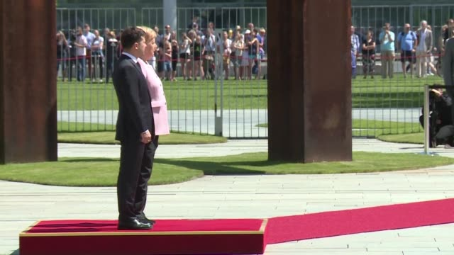 german chancellor angela merkel appears unsteady and was shaking as she stands in the midday sun next to visiting ukrainian president volodymyr... - midday stock videos and b-roll footage