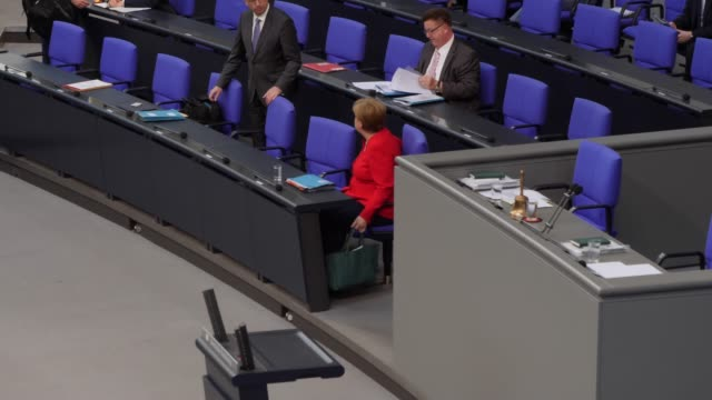 german chancellor angela merkel arrives and waits for a question and answer session of the federal government at the bundestag on june 26 2019 in... - angela merkel stock videos & royalty-free footage