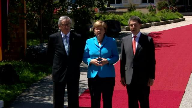 German Chancellor Angela Merkel arrives with husband Joachim Sauer and greets European Union Commission President JeanClaude Juncker G7 member states...