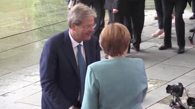 german chancellor angela merkel greets british prime minister theresa may president of france emmanuel macron european council president donald tusk... - group of 20 stock videos & royalty-free footage
