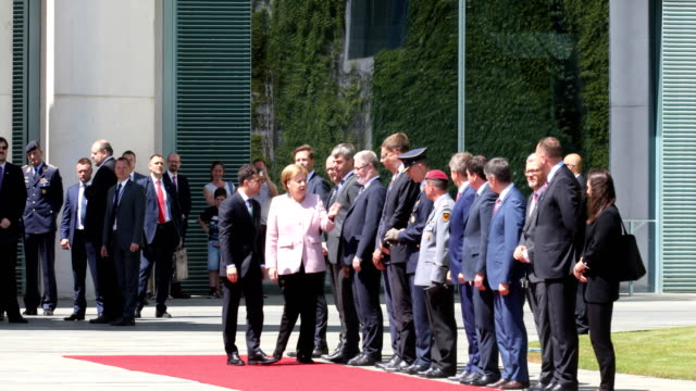vídeos de stock e filmes b-roll de german chancellor angela merkel greets members of the ukrainian government delegation at the chancellery on a hot day on june 18, 2019 in berlin,... - politician