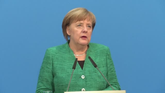 German Chancellor Angela Merkel hailed a hard fought deal Wednesday on a new grand coalition government which she said international partners had...