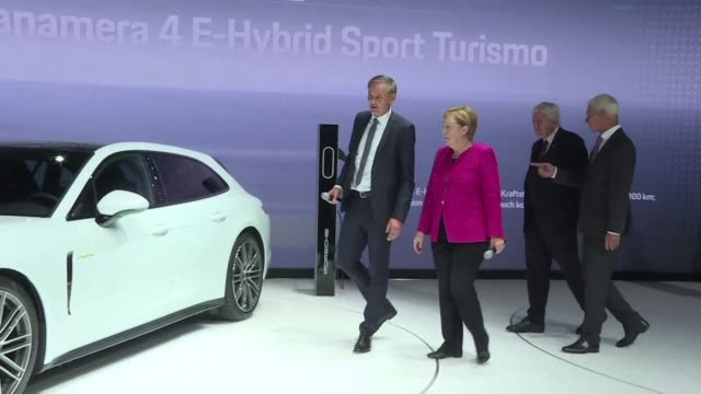 german chancellor angela merkel in the middle of her election campaign visited german carmakers on thursday the frankfurt motor show - handelsmesse stock-videos und b-roll-filmmaterial