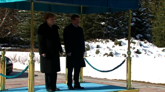 german chancellor angela merkel is welcomed by turkish prime minister ahmet davutoglu with an official welcoming ceremony prior to their meeting at... - トルコ首相点の映像素材/bロール