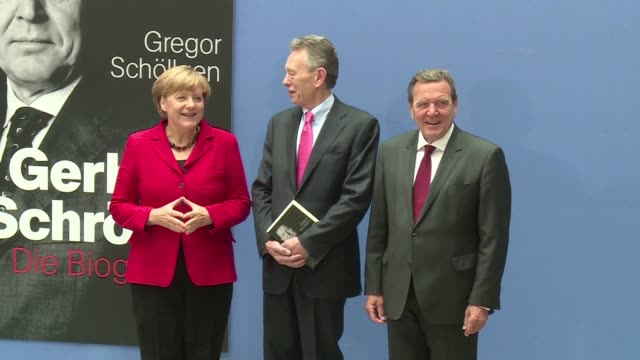 german chancellor angela merkel joins gerhard schroeder for the launch of a new biography on the former chancellor - biography stock videos & royalty-free footage