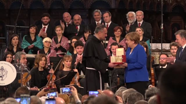 german chancellor angela merkel receives the lamp of st francis the catholic nobel prize from franciscan monks in assisi italy and takes part in a... - assisi stock videos and b-roll footage